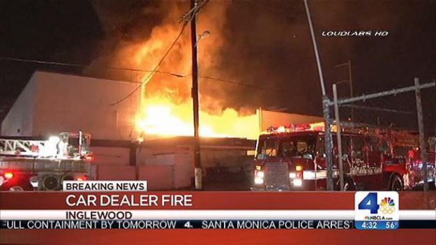 Two stranded in vacant dealership fire