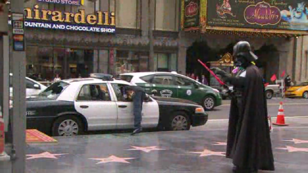Darth Vader Watches Man Smash LAPD Windows