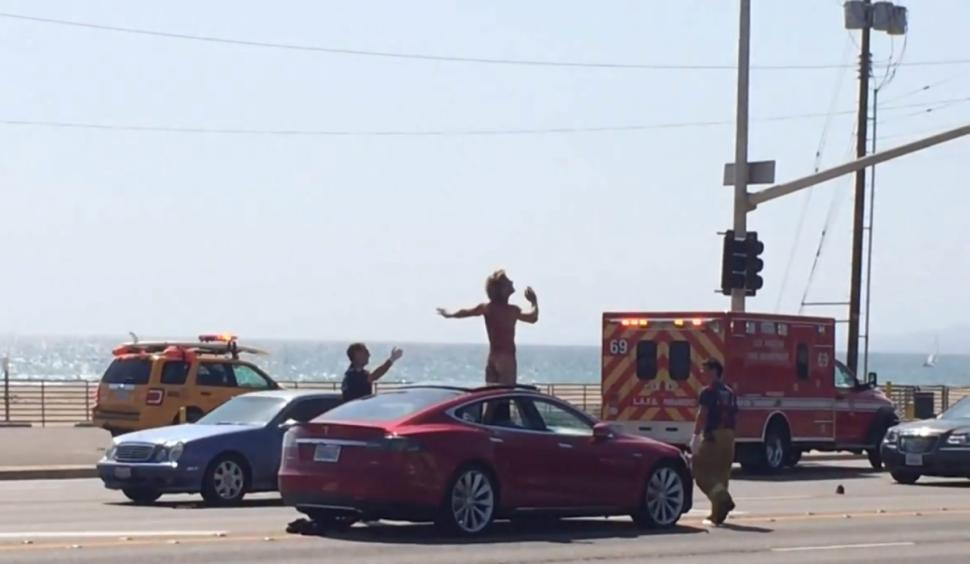 Naked Man Stops LA Traffic After Climbing On Roof Of Tesla